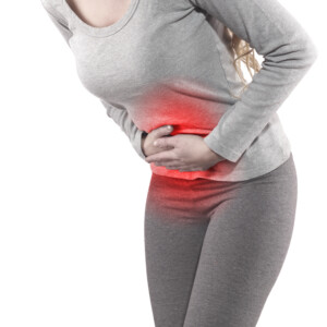 Woman in pain clutching stomach